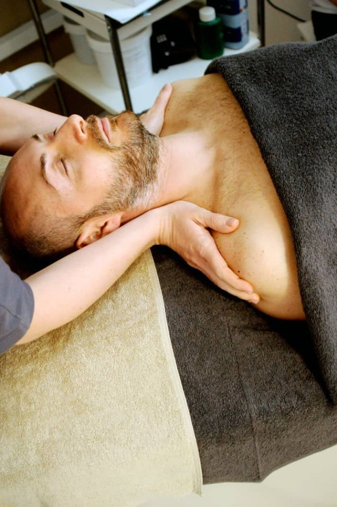 A man undergoing a massage therapy from a well-trained masseur